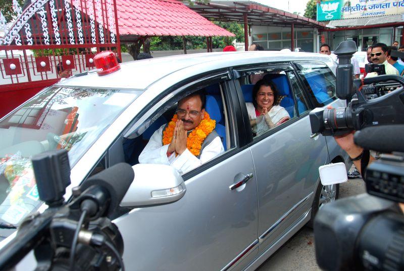 The leader of opposition in Uttarakhand Assembly Ajay Bhatt departs for Uttarakashi, ahead of  opening the portals of Gangotri shrine, from Dehradun on April 15, 2015.