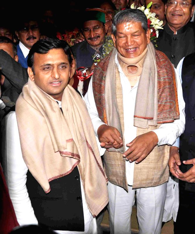 Uttar Pradesh Chief Minister Akhilesh Yadav with Uttarakhand Chief Minister Harish Rawat in Dehradun on Dec 1, 2014. - Akhilesh Yadav