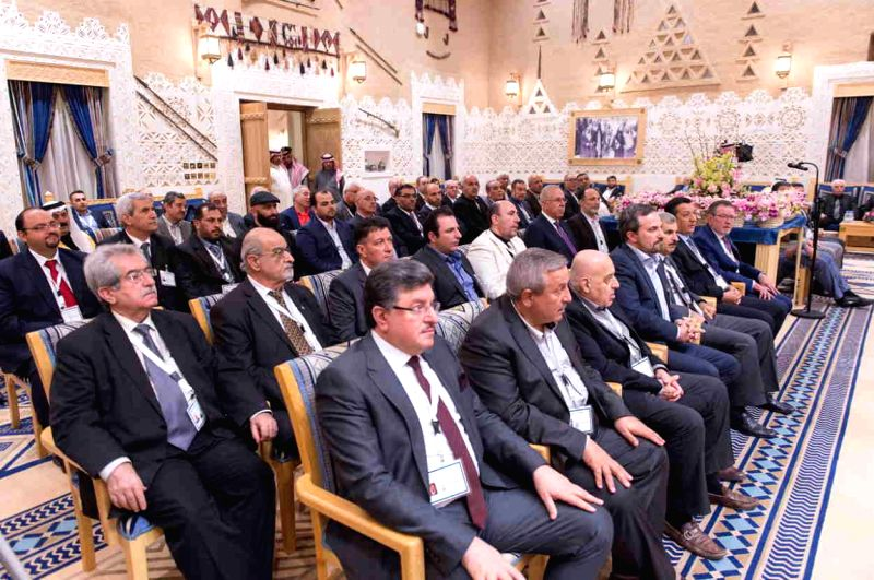 Delegates of the Syrian opposition meet in Riyadh, Saudi Arabia, Dec. 10, 2015. Syrian oppositions announced on Thursday they might meet with President Bashar ...
