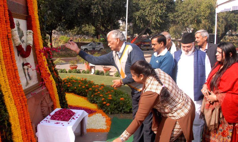 Delhi Assembly Speaker Ram Niwas Goel pays tribute to the portrait of Mahatma Gandhi on his death anniversary at Delhi Vidhan Sabha in New Delhi on Jan 30, 2018. - Ram Niwas Goel