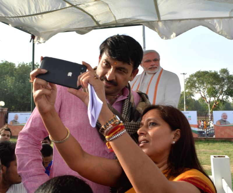 Delhi BJP chief Manoj Tewari takes a selfie during Modi Fest being organised at Red Fort Grounds in New Delhi, on June 3, 2017.