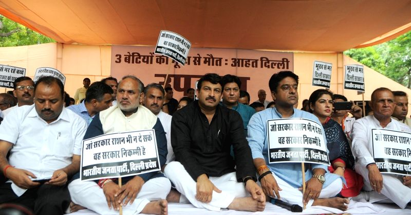 Delhi BJP chief Manoj Tiwari along with party workers stage a demonstration over the the starvation deaths of three minor girls, in New Delhi on July 28, 2018.