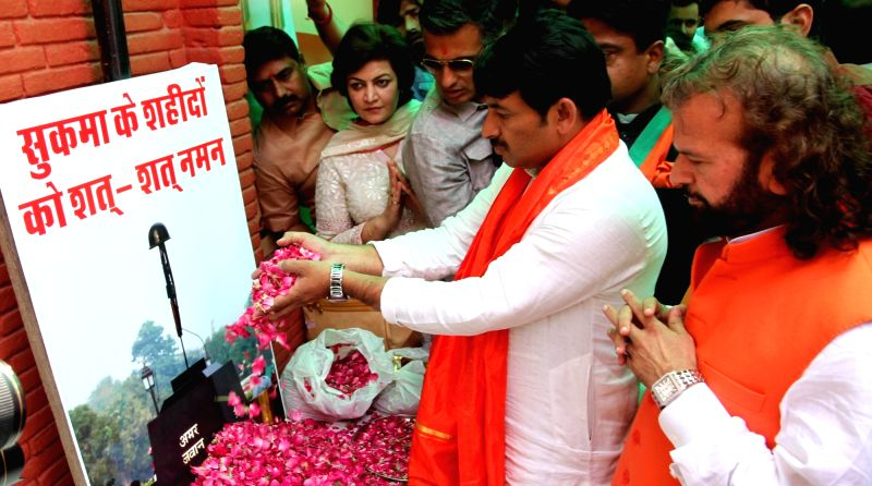 Delhi BJP chief Manoj Tiwari and sufi singer and party leader Hans Raj Hans pay tributes to the martyred CRPF personnel in New Delhi on April 26, 2017. 25 CRPF personnel were killed in a ...