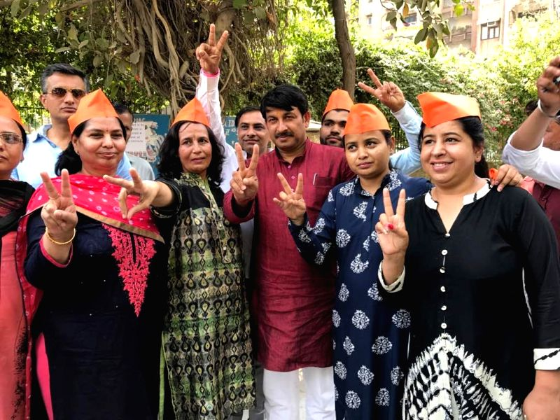 Delhi BJP chief Manoj Tiwari at a polling booth during MCD polls in New Delhi on April 23, 2017.