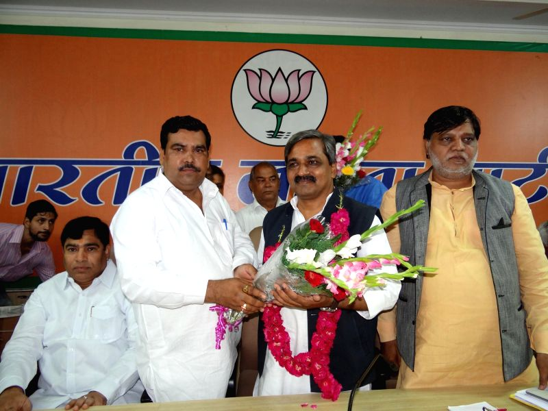 Delhi BJP chief Satish Upadhyay being felicitated during a programme organised by  party's SC/ST Morcha in New Delhi on July 20, 2014.