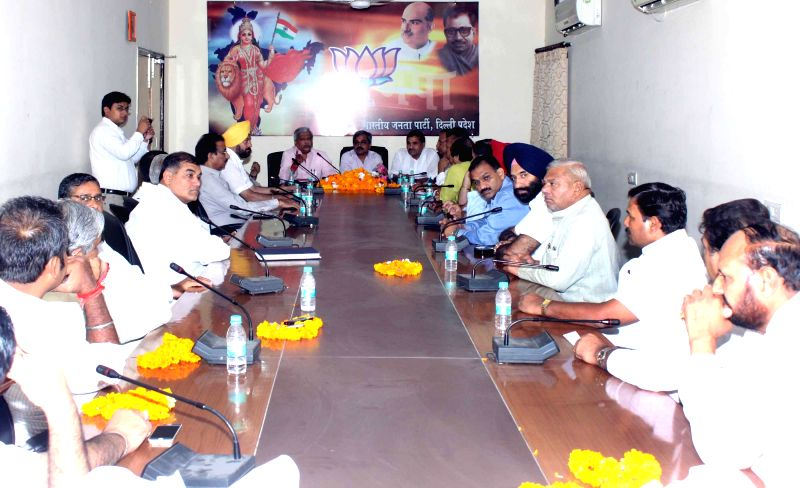 Delhi BJP chief Satish Upadhyay during a meeting with party legislators at party office in New Delhi on July 16, 2014.