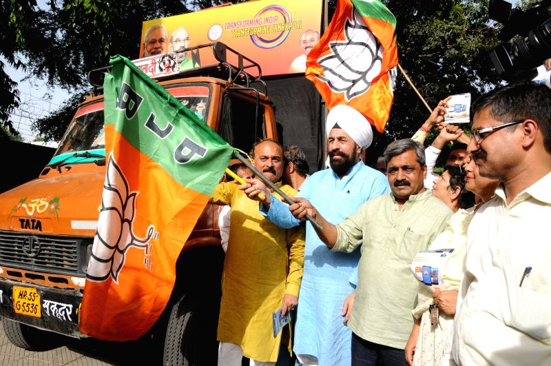 "Delhi BJP chief Satish Upadhyay flags off ""Transforming India Rath"" to spread achievements of Modi government in last two years in New Delhi, on June 2, 2016. - Satish Upadhyay"