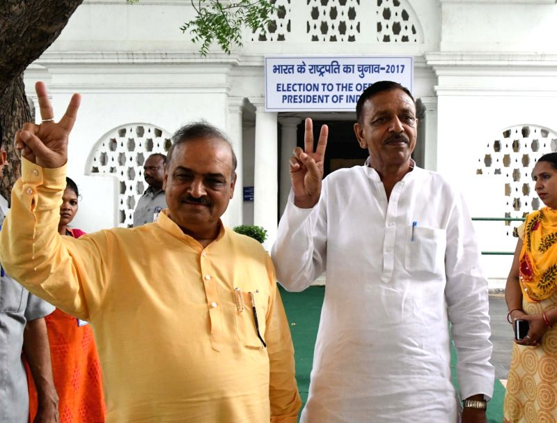 Delhi BJP Legislators OP Sharma and Jagdish Pradhan after casting his vote during presidential polls at Delhi Assembly in New Delhi on July 17, 2017.