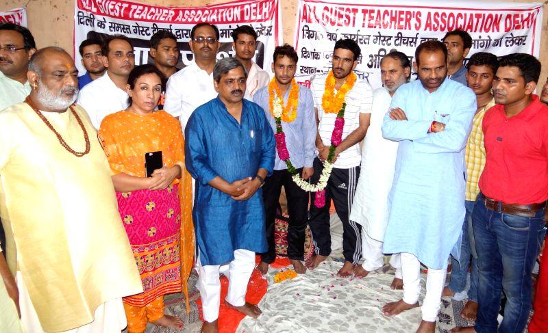 Delhi BJP president Satish Upadhyay and South Delhi BJP MP Ramesh Bidhuri in New Delhi on July 21, 2014.