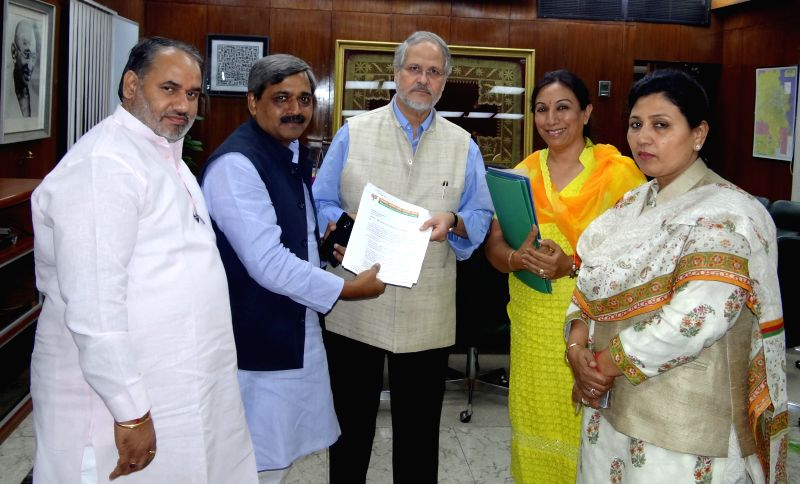 Delhi BJP president Satish Upadhyay during a meeting with Delhi Lt Governor Najeeb Jung in New Delhi on July 25, 2014.
