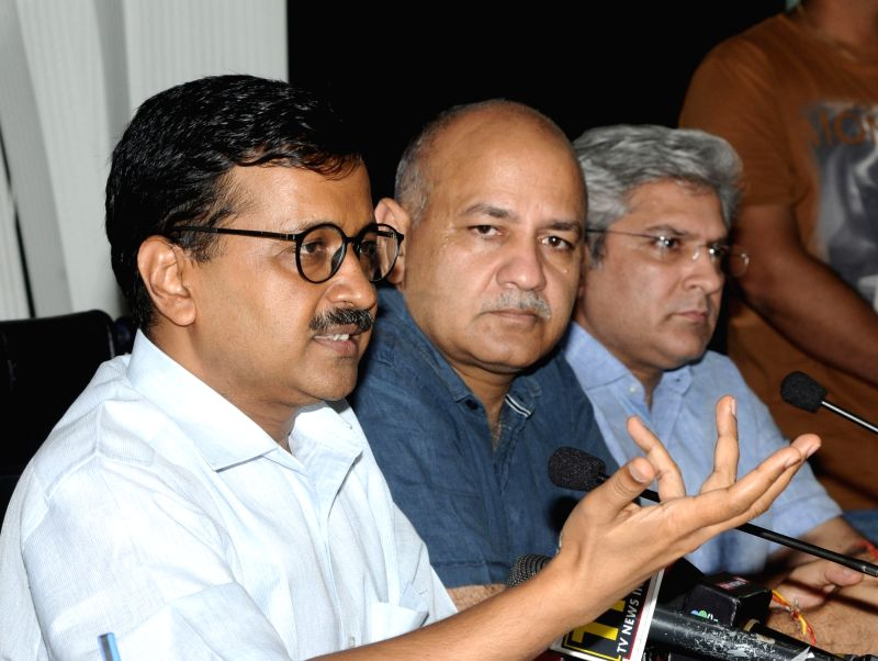 Delhi Chief Minister Arvind Kejriwal addresses a press conference along with Deputy Chief Minister Manish Sisodia and state Transport Minister Kailash Gahlot, in New Delhi on July 24, 2018. - Arvind Kejriwal