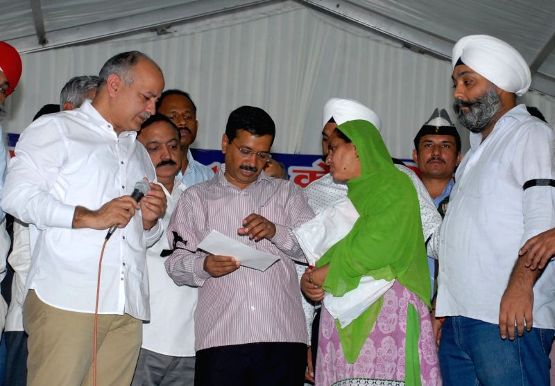 Delhi Chief Minister Arvind Kejriwal and Deputy Chief Minister Manish Sisodia during a programme organised to distribute cheques to the victims of 1984 riots  in New Delhi, on Nov 1, 2015. - Arvind Kejriwal