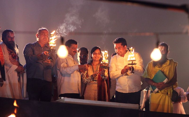 Delhi Chief Minister Arvind Kejriwal and Deputy Chief Minister Manish Sisodia participate during a `Yamuna Aarti` in New Delhi on Nov. 13, 2015.