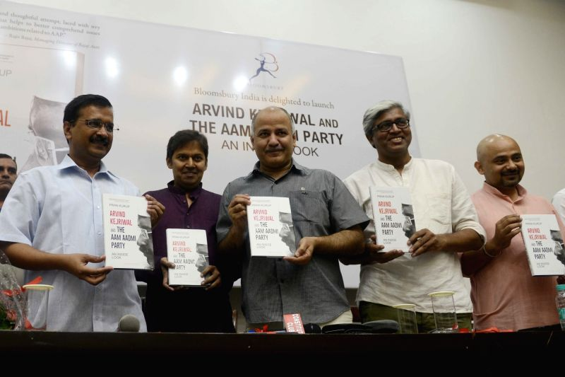 "Delhi Chief Minister Arvind Kejriwal and Deputy Chief Minister Manish Sisodia during the release of a book ""Arvind Kejriwal and The Aam Admi Party An Inside Look"" written by Pran ... - Arvind Kejriwal and Dilip Pandey"