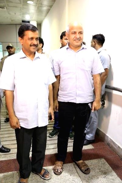 Delhi Chief Minister Arvind Kejriwal and Deputy Chief Minister Manish Sisodia arrive to attend a special show of Disney's Aladdin - the Broadway style musical at Jawaharlal Nehru Indoor ... - Arvind Kejriwal