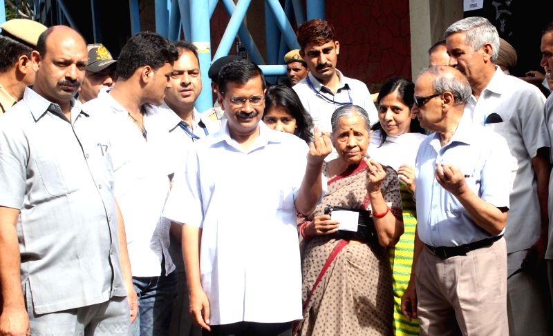 Delhi Chief Minister Arvind Kejriwal and his family members come out after casting their votes during MDC elections in New Delhi on April 23, 2017. - Arvind Kejriwal