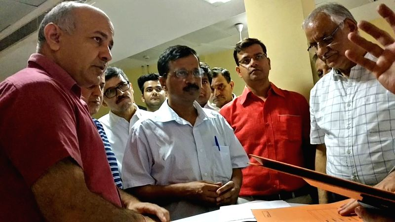 Delhi Chief Minister Arvind Kejriwal and his Deputy Manish Sisodia talk with doctors to know the conditions of students who fell ill due to gas leak near the school in New Delhi on May 6, ... - Arvind Kejriwal