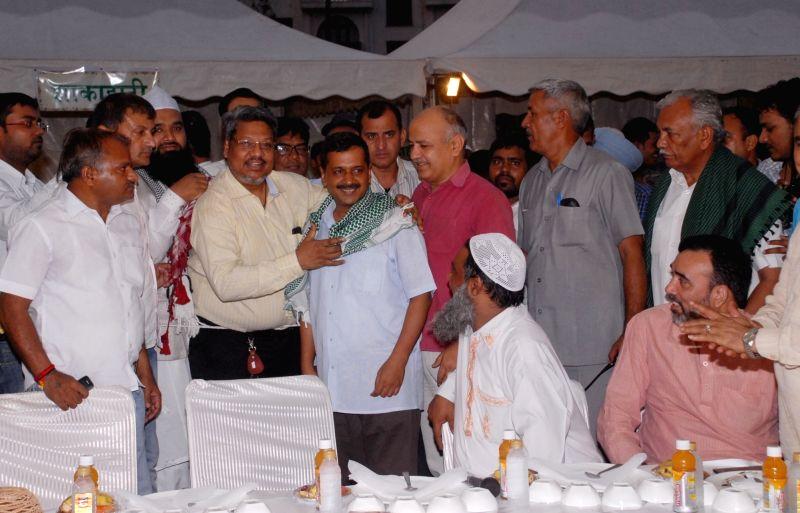 Delhi Chief Minister Arvind Kejriwal, Deputy Chief Minister Manish Sisodia and Labour Minister Gopal Rai during an Iftaar party at Delhi Vidhan Sabha in New Delhi on June 19, 2017. Also ... - Arvind Kejriwal and Gopal Rai