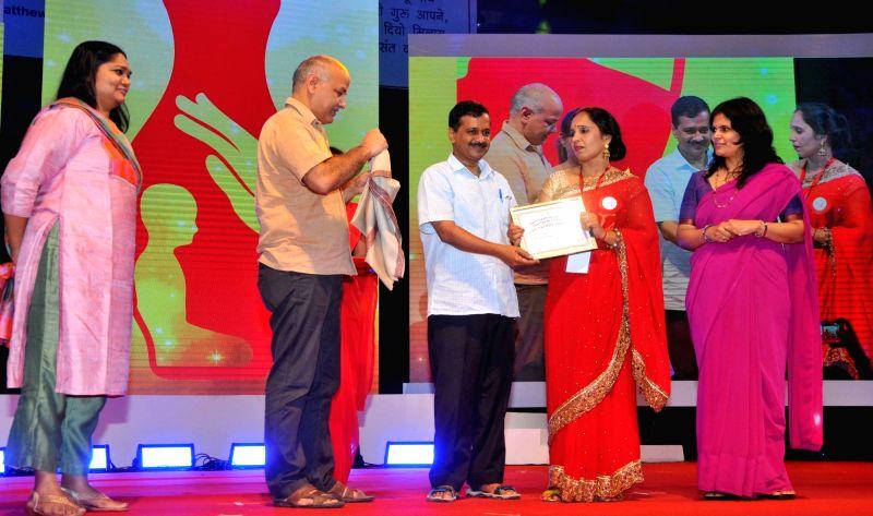 Delhi Chief Minister Arvind Kejriwal felicitates teachers during a programme on Teacher's Day on Sept 5, 2017. Also seen Delhi Deputy Chief Minister Manish Sisodia. - Arvind Kejriwal