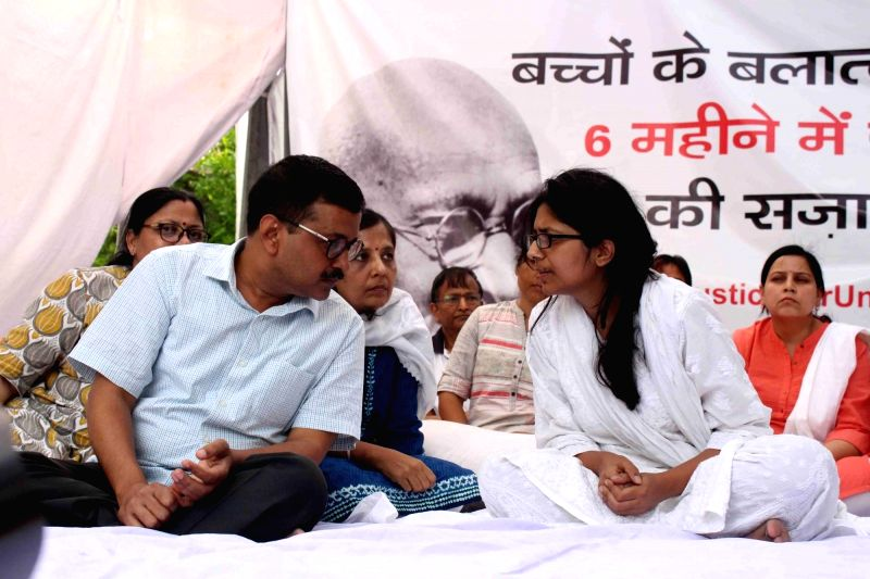 Delhi Chief Minister Arvind Kejriwal meets Delhi Commission for Women (DCW) Chairperson Swati Maliwal who is sitting on an indefinite hunger strike to press for death penalty for rapists ... - Arvind Kejriwal