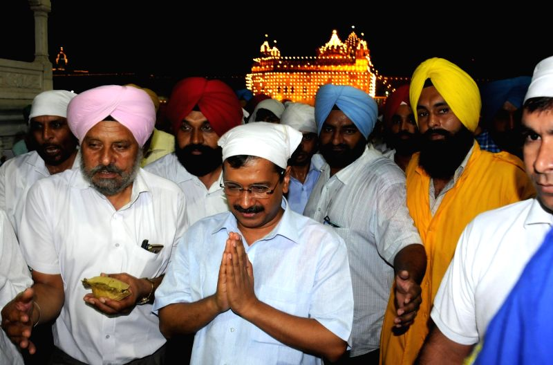 Delhi Chief Minister Arvind Kejriwal pays obeisance at the Golden Temple in Amritsar on July 28, 2016. - Arvind Kejriwal