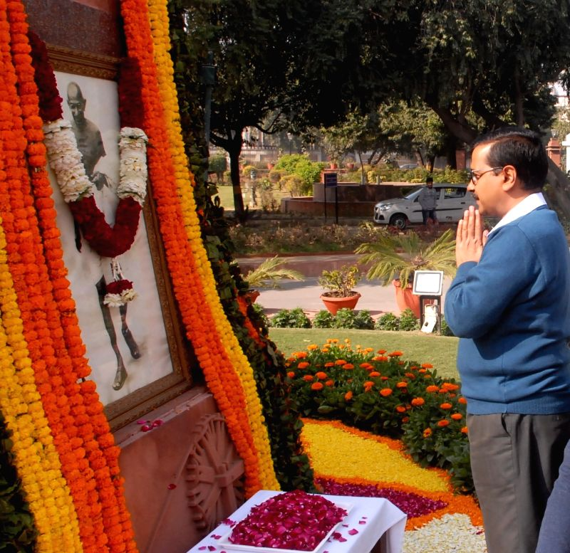 Delhi Chief Minister Arvind Kejriwal pays tribute to the portrait of Mahatma Gandhi on his death anniversary at Delhi Vidhan Sabha in New Delhi on Jan 30, 2018. - Arvind Kejriwal
