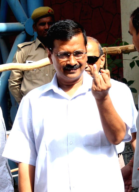 Delhi Chief Minister Arvind Kejriwal shows his finger marked with phosphorus ink after casting votes during MDC elections in New Delhi on April 23, 2017. - Arvind Kejriwal