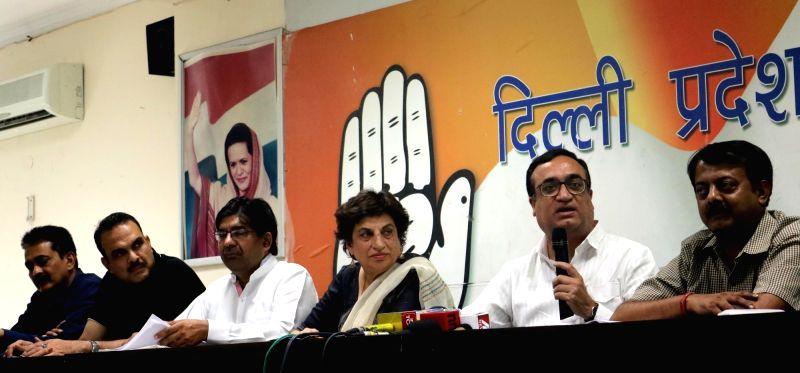 Delhi Congress chief Ajay Maken addresses a press conference in New Delhi, on May 25, 2016. Also seen Congress leader Kiran Walia.