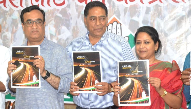 Delhi Congress chief Ajay Maken and party leader Sharmistha Mukherjee release manifesto for upcoming Delhi MCD polls in New Delhi on April 18, 2017. - Sharmistha Mukherjee