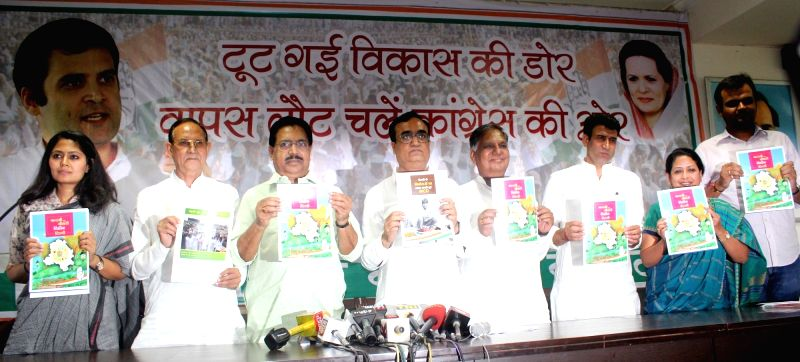 Delhi Congress chief Ajay Maken releases manifesto for upcoming Delhi MCD Polls in New Delhi on April 17, 2017.