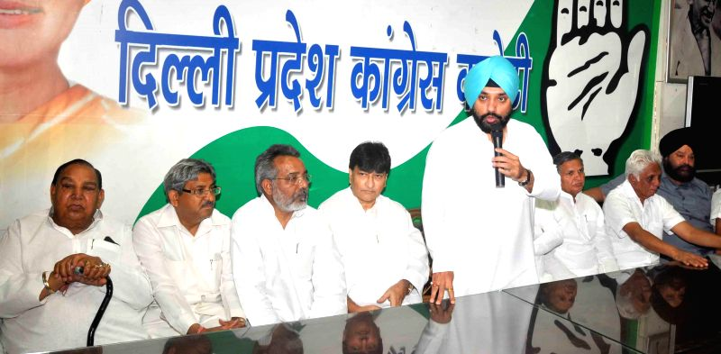 Delhi Congress chief Arvinder Singh Lovely addresses during a party meeting in New Delhi on May 18, 2014. Also seen party leaders Haroon Yusuf, Chaudhary Prem Singh, Yoganand Shastri, Amrish Gautam .. - Arvinder Singh Lovely and Chaudhary Prem Singh