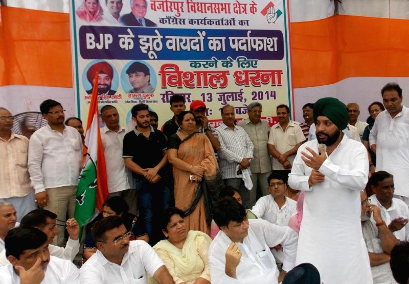 Delhi Congress chief Arvinder Singh Lovely addresses during a demonstration against hike in prices of essential commodities and other issues in New Delhi on July 13, 2014. - Arvinder Singh Lovely