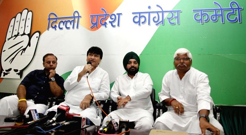 Delhi Congress chief Arvinder Singh Lovely, Haroon Yusuf and others during a press conference in New Delhi on Sept 1, 2014. - Arvinder Singh Lovely