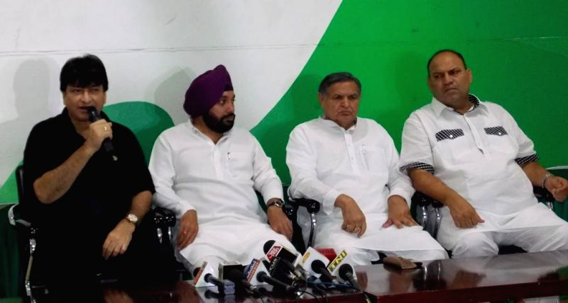Delhi Congress Chief Arvinder Singh Lovely with Haroon Yusuf and other party leaders during a press conference in New Delhi on Aug 4, 2014.