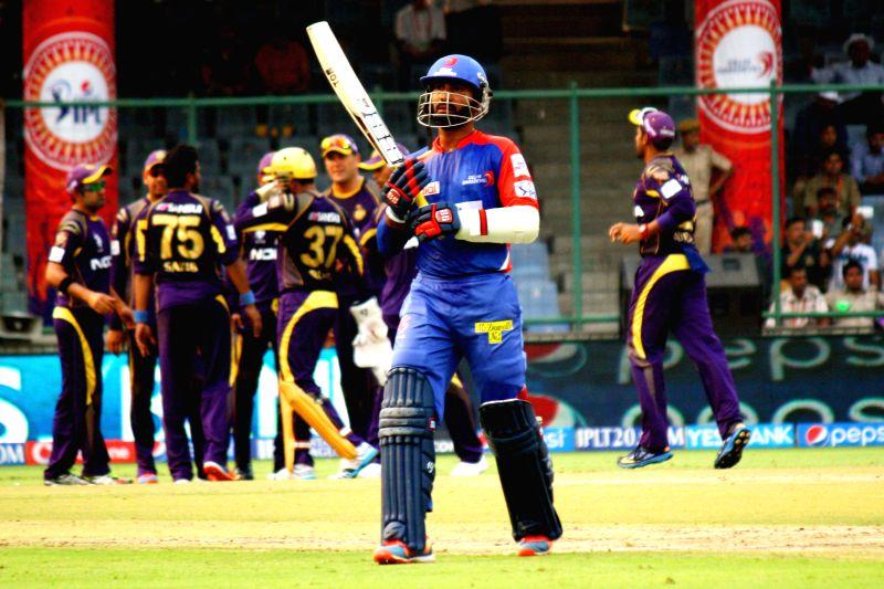 Delhi Daredevils batsman Dinesh Karthik returns back to the pavilion after getting dismissed during the 28th match of IPL 2014 between Delhi Daredevils and Kolkata Knight Riders at Feroz Shah Kotla .. - Dinesh Karthik and Feroz Shah Kotla