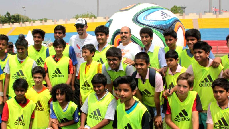 Delhi Daredevils captain Kevin Pietersen with young footballers during an event organised to promote football in New Delhi on May 4, 2014.