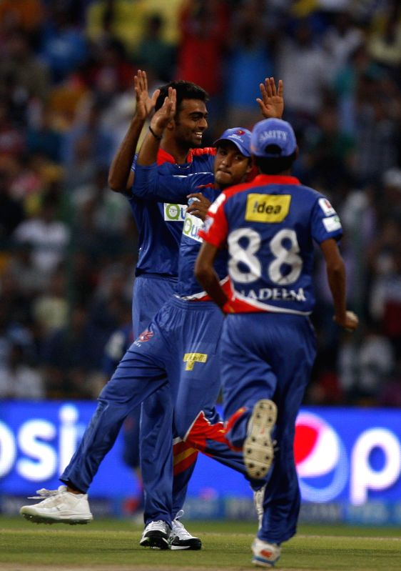 Delhi Daredevils celebrate fall of a wicket during the eighth match of IPL 2014 between Chennai Super Kings and Delhi Daredevils, played at Sheikh Zayed Stadium in Abu Dhabi of United Arab Emirates ..