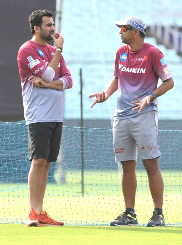 Delhi Daredevils coach Rahul Dravid interacts with captain Zaheer Khan during a practice session at Eden Gardens in Kolkata on April 27, 2017. - Zaheer Khan and Rahul Dravid