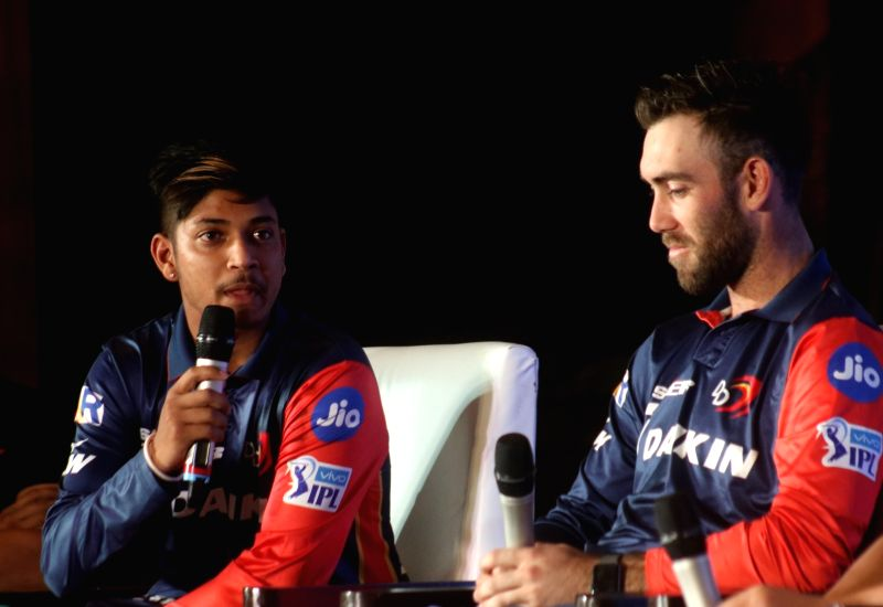 Delhi Daredevils' Sandeep Lamichhane and Glenn Maxwell during a programme in New Delhi on May 16, 2018.