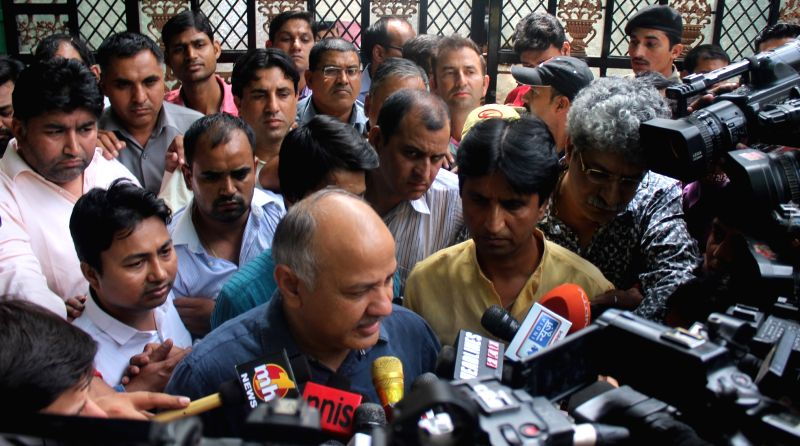 Delhi Deputy Chief Minister and AAP leader Manish Sisodia with party leader Kumar Vishwas talks to press after Aam Aadmi Party's PAC meeting outside Chief Minister residence in New Delhi ...