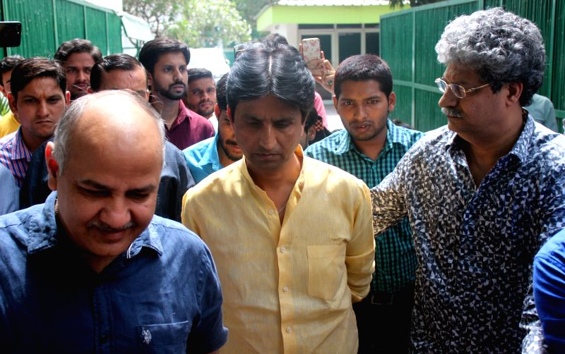 Delhi Deputy Chief Minister and AAP leader Manish Sisodia with party leader Kumar Vishwas outside the Chief Minister residence after Aam Aadmi Party's PAC meeting in New Delhi on May 3, ...