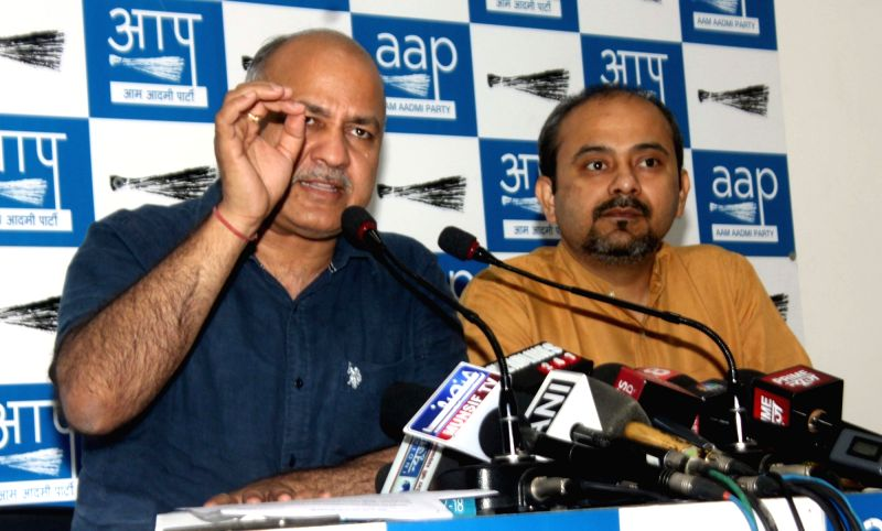 Delhi Deputy Chief Minister Manish Sisodia addresses a press conference in New Delhi on April 18, 2017. Also seen AAP's Delhi unit convenor Dilip Pandey. - Manish Sisodia and Dilip Pandey