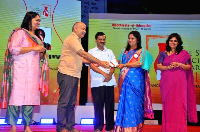 Delhi Deputy Chief Minister Manish Sisodia felicitates teachers during a programme on Teacher's Day on Sept 5, 2017. Also seen Delhi Chief Minister Arvind Kejriwal. - Manish Sisodia and Arvind Kejriwal