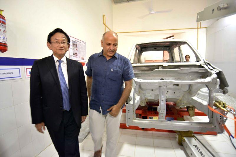 Delhi Deputy Chief Minister Manish Sisodia and Maruti Suzuki MD & CEO Kenichi Ayukawa at Automobile Enhancement Centre of ITI Nizamuddin in New Delhi on May 25, 2017. - Manish Sisodia