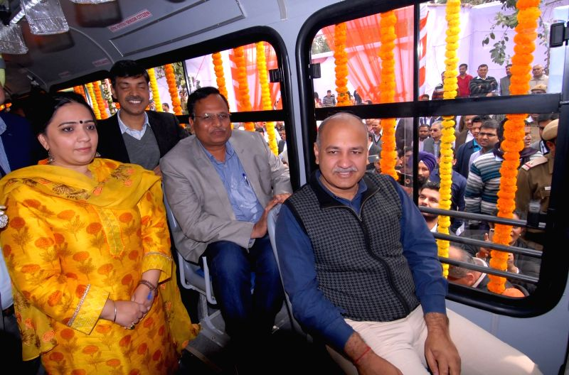 Sisodia flags off 100 new GPS enabled buses - Manish Sisodia and Satyendar Jain