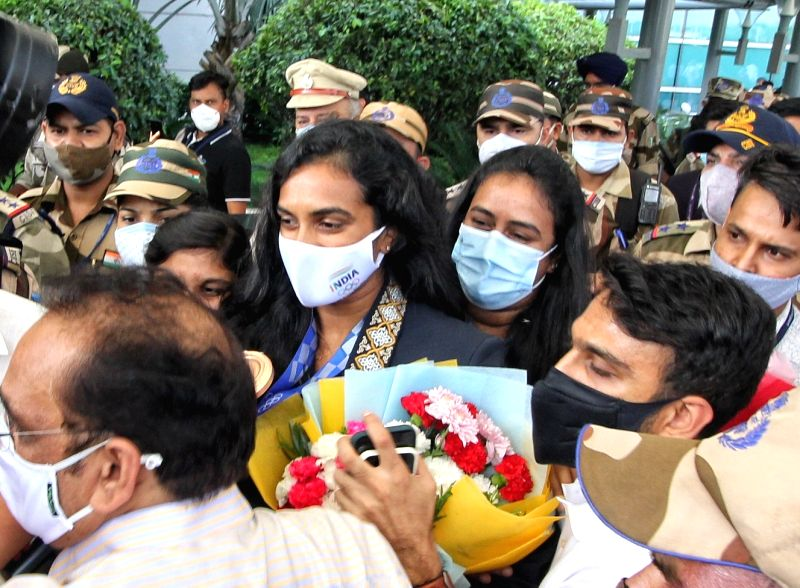 Delhi: Double Olympic medallist PV Sindhu returns home to grand welcome at the Delhi airport on Tuesday, August 03, 2021.(Photo: Wasim Sarvar/IANS)