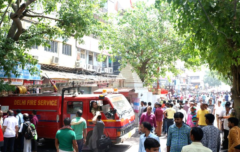 Delhi Fire Service personnel inspect the area where a major fire broke out in a cloth shop in Chandni Chowk, Delhi on May 23, 2017.