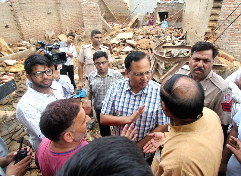 Delhi Health and Transport Minister Satyendra Jain visits the site where a woman and her two sleeping children were crushed to death in a roof collapse in West Delhi's Uttam Nagar area on ... - Satyendra Jain
