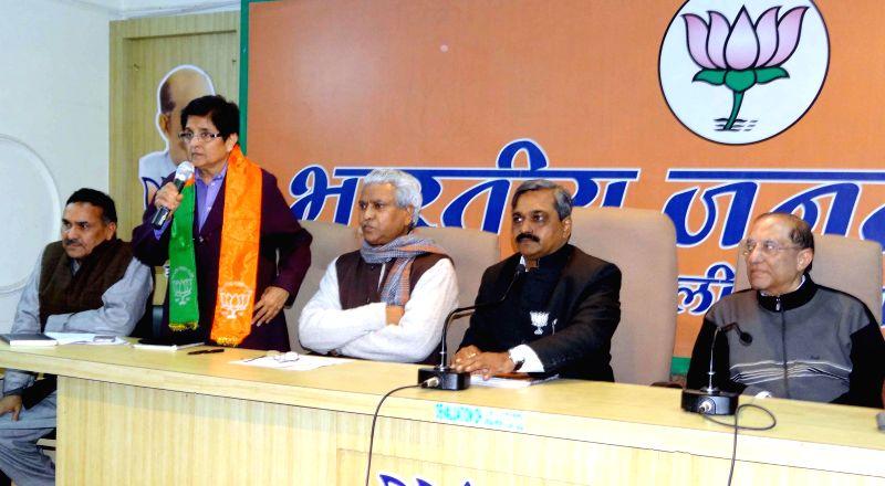 Delhi in-charge of BJP Prabhat Jha, Delhi BJP chief Satish Upadhyay and Kiran Bedi during a party meeting in New Delhi, on Jan 23, 2015. - Satish Upadhyay and Kiran Bedi