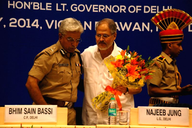 Delhi Lt. Governor Najeeb Jung and Delhi Police Commissioner B.S. Bassi during launch of new Mobile Application and Upgraded Website of Delhi Traffic Police in New Delhi on  May 8, 2014.